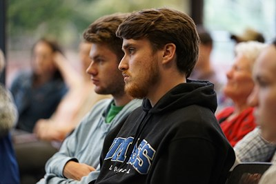 students listen to the panelists
