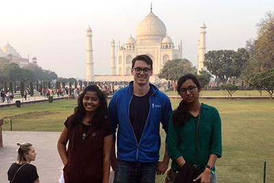 Student Will Hanna stands in front of the Taj Mahal with two students from India