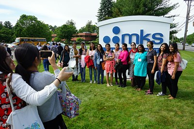 Students from India take a photo during a visit to MKS Instruments in Methuen