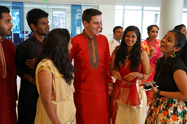 Senior economics major Mike Maguire, center, catches up with students he met in Hubli, India, during a Global Entrepreneurship and Innovation program reception at University Crossing.