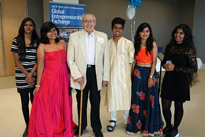 Manning founder Stuart Mandell poses with visiting students