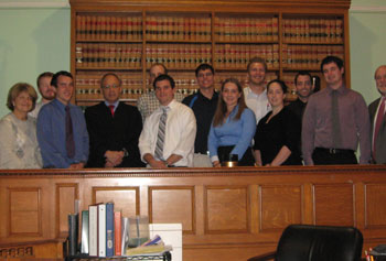 Asst. Prof. Pat Fontaine and her class with Superior Court Judge John Lu at Superior Courthouse in Lowell.