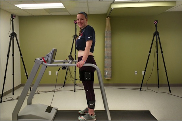 Exercise physiology major Stephanie Esker demonstrates testing equipment in the Health Assessment Laboratory. Researchers will use the technology to study how gait rehabilitation repairs brain neurons in stroke survivors.