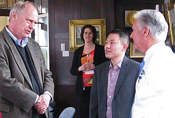 GENI Project Director Chip Elliott, left, talks to Chancellor Marty Meehan and Assoc. Prof. Yan Luo during a meeting at Allen House on South Campus on April 10. Looking on is Marcie Byrd of the IT Department.