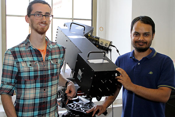 Physics graduate students George Geddes, left, and Saurav Aryal will operate HiT&MIS, a custom-built, multi-slit imaging spectrometer, at their observing site in Carbondale, Ill.