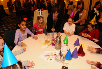 "Girls Inc., a partner with UMass Lowell for ""Dickens in Lowell,"" celebrated the author's 200th birthday with Victorian parlor games at the Inn & Conference Center."