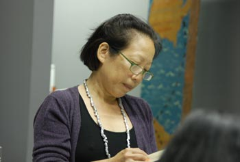 Author Gish Jen gave a reading at a symposium on immigrant identities.