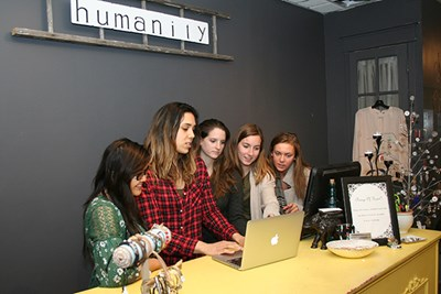 Students work with Ani Vong in Humanity Boutique