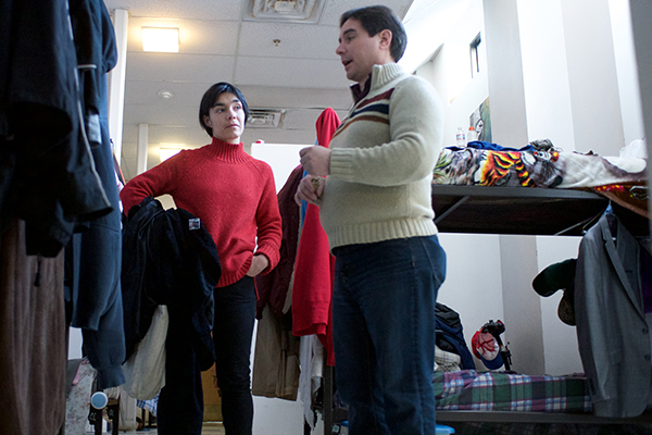 Grant-writing student Charlette Renault-Caragianes tours the Lowell Transitional Living Center, her community client, with executive director Josh White.