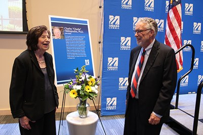 Efthemia Nikitopoulos with History Prof. Robert Forrant at the opening of an exhibit on Greek immigration history dedicated to her late husband, UMass Psychology Prof. Charles Nikitopoulos.