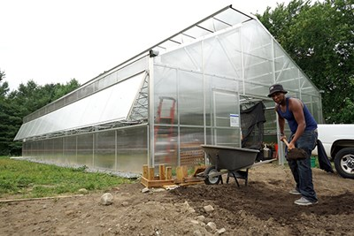Junior Jose Tapia volunteers at the new Urban Agriculture Greenhouse