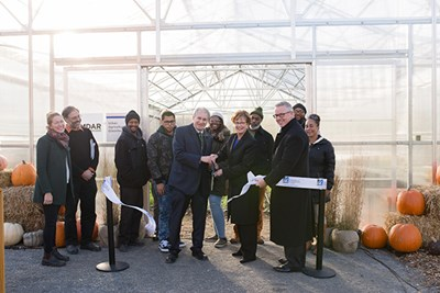 Chancellor Jacquie Moloney and guests cut the ribbon on the greenhouse