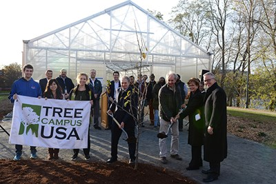 An Asian pear tree is planted in a ceremony at the greenhouse