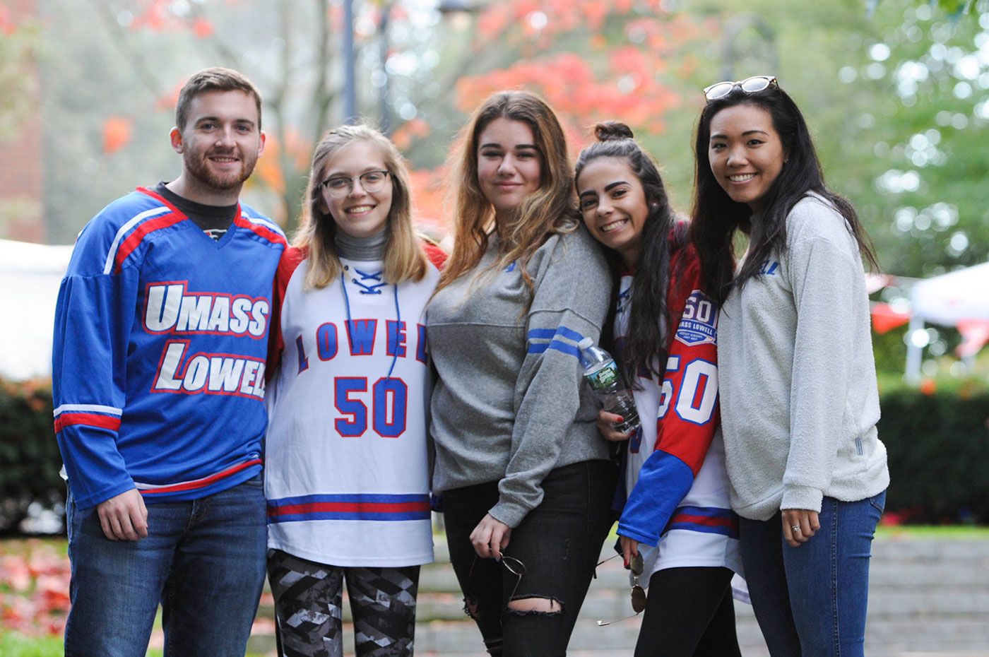 Group of students in River Hawk Hockey Jersey's outside at the Engagement Fair