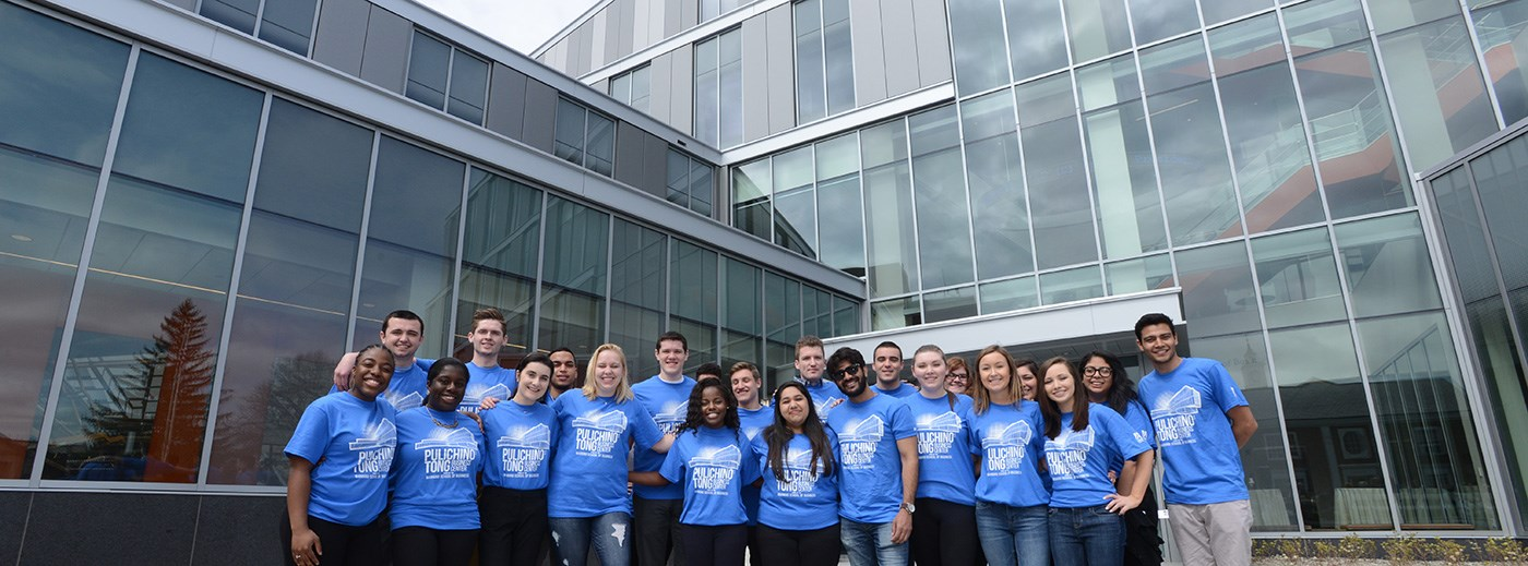 Students standing in front of the newly opening Pulichno-Tong Business Building at UMass Lowell.