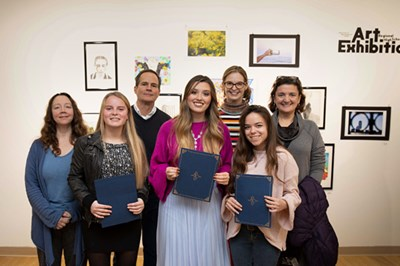 At UML's Dec. 2 opening reception for high school artists, left to right, Gallery Director Deborah Santoro, Anya Crowley of Landmark Academy, Prof. Stepehn Mishol, Autumn Bellan of Chelmsford High School, Prof. Ellen Wetmore, Mary Elizabeth Miller of Haverhill High School, Prof. Ingrid Hess.