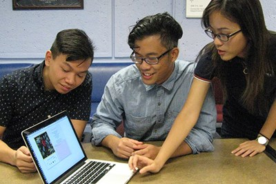 Computer science students Kody Thach, Cullin Lam and Huong Nguyen demonstrate the app they created at the Shark Hack.