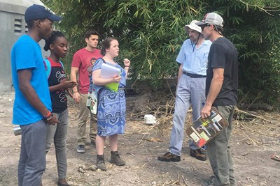 UMass Lowell Civil and Environmental Engineering students Kayla Dooley and Paul Salibe on site in Les Cayes, Haiti for their alternative capstone project designing sanitation systems for houses