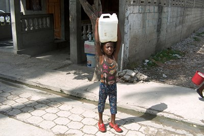 A girl carrying water in Haiti.