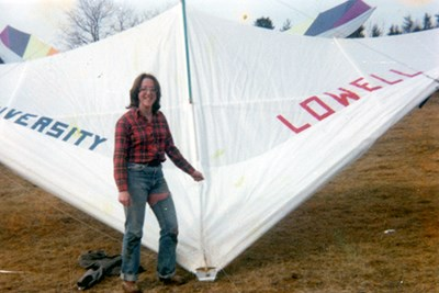 A student poses with their hang glider