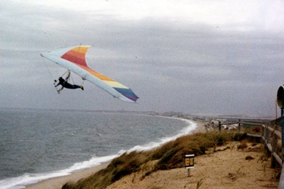 A student sails off the dunes at Cape Cod