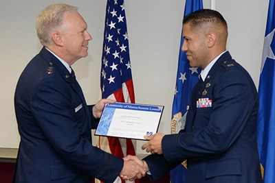 Lt. Gen. John Thompson awards a certificate of completion of UMass Lowell's engineering management course to Air Force Capt. Jeffrey Rodriguez.