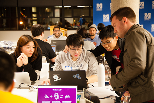 A team of students work through the night during the university's first-ever Hawkathon at the Innovation Hub.