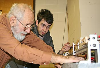 Physics instructor Herbert Fox and student Frank Gelsomini work in the physics lab.