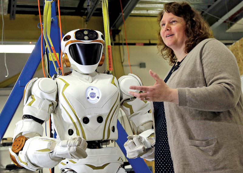 UMass Lowell Prof. Holly Yanco stands with robot, Valkyrie