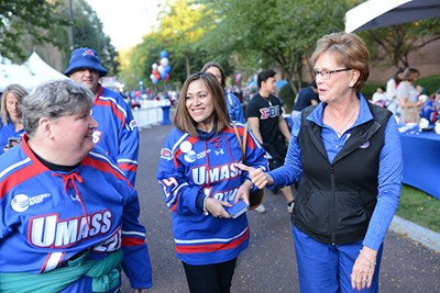 Chancellor Jacquie Moloney chats with River Hawks at Homecoming
