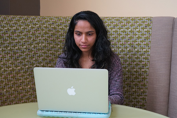 Honors biology major Dhruvi Patel studies for finals in Cumnock Marketplace.