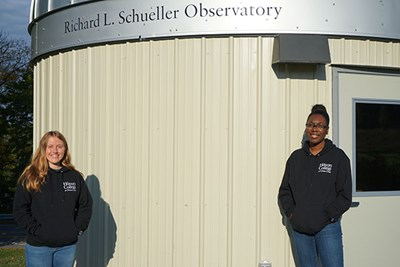 Physics majors Michele Woodland, left, and Shanice Kelly work at the new Schueller Astronomical Observatory.