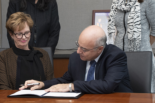 Dean of Sciences Noureddine Melikechi goes over the Universal Declaration of Humankind Rights and Duties with Chancellor Jacquie Moloney. UMass Lowell is the first U.S. university to endorse it.