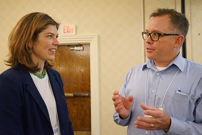 GAO analyst-in-charge Nora Boretti talks with conference participant Bill Roche  at Voices of Hunger 2019