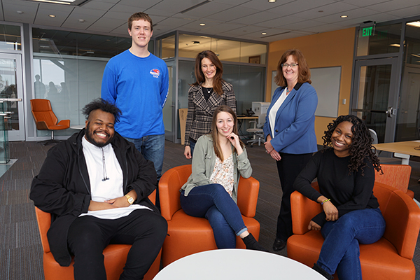 The Manning School's IBECC team includes students, from left, Shakeem Browne, Kelly Skelton, Elianna Makiej and Maya Crawford and faculty members Erica Steckler, center back, and Elissa Magnant. Not pictured is team member Evan Cotreau.