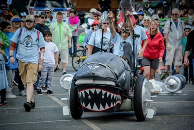 Jay Hungate steers his contraption during Lowell first kinetic sculpture race.