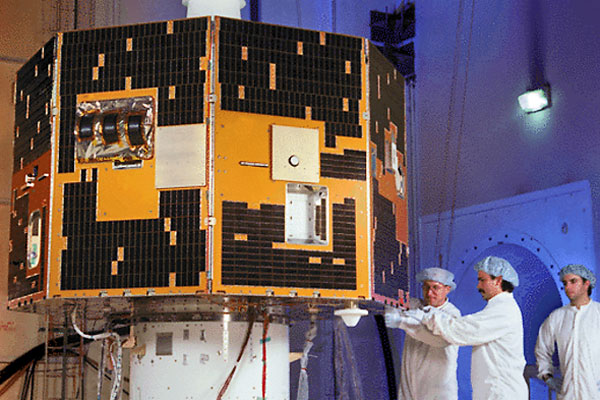 Technicians prepare NASA's IMAGE satellite for launch in 2000. Mission controllers lost contact with the 1,100-pound spacecraft on Dec. 18, 2005.