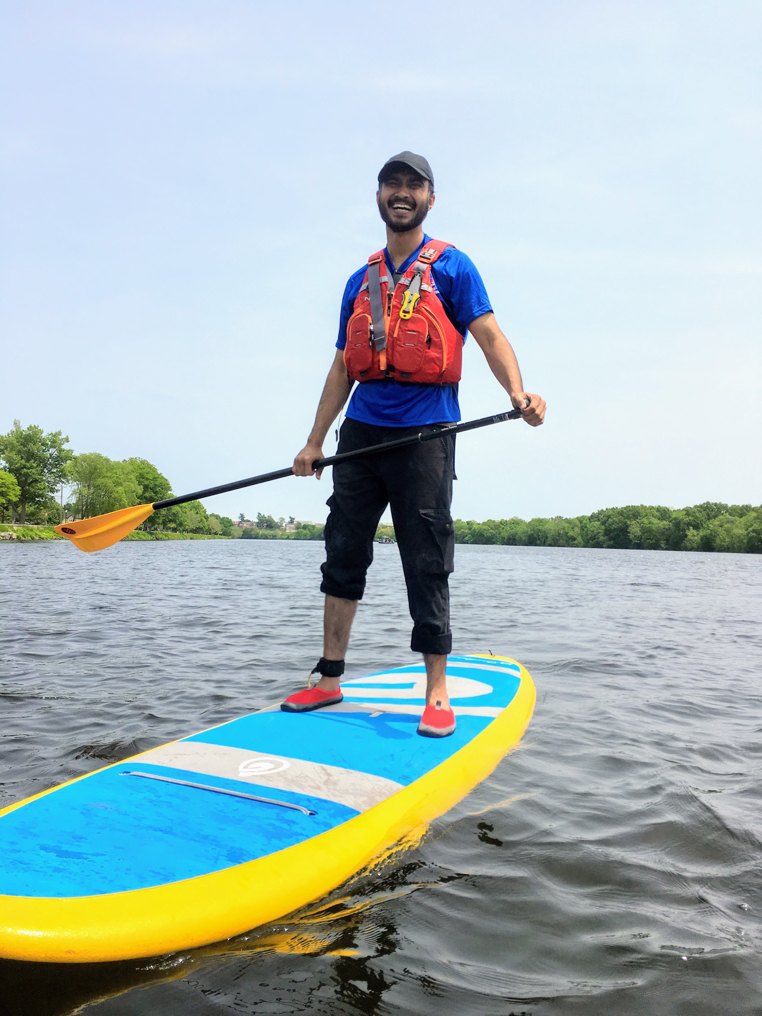 Stand-up Paddle Boarder smiling.