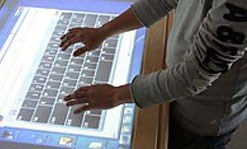UMass Lowell student demonstrates self-built multi-touch screen