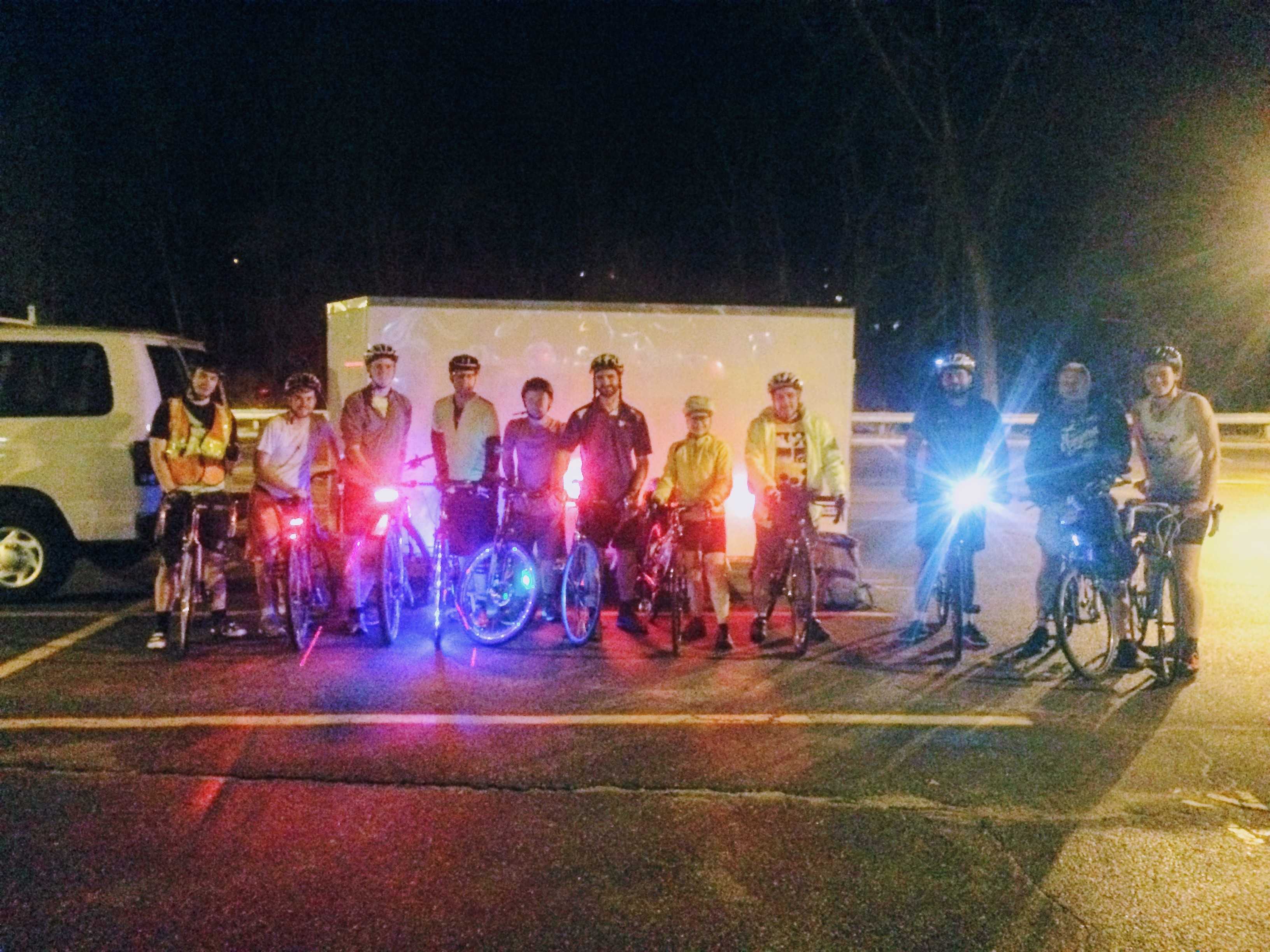 Bicyclists posing with reflective equipment and fun lights