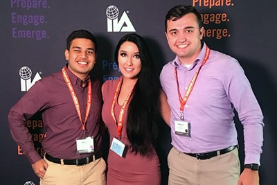 Students Sam Patel, Caroline Burgess and Shaymus Dunn pose together at the Internal Audit Student Exchange conference