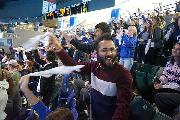 Ph.D. student Sachin Gupta celebrates a River Hawks goal during their season-opening win at the Tsongas Center.
