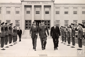 Sen. John F. Kennedy, on campus to receive an honorary degree, exits the newly opened Cumnock Hall in Sept. 1956.