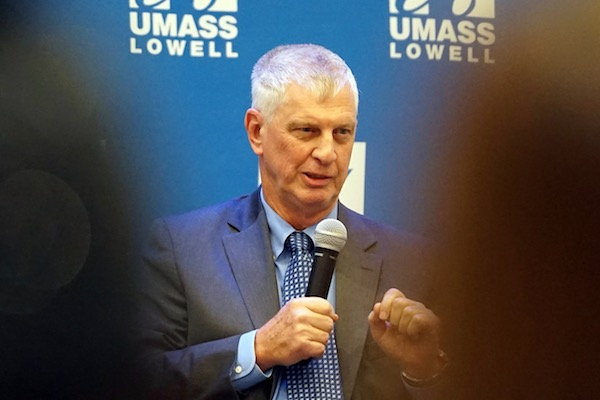 UMass President Emeritus Jack Wilson, seen here taking part in the Donahue Center's distinguished speaker series in 2018, was a pioneer in online video conferencing technology.