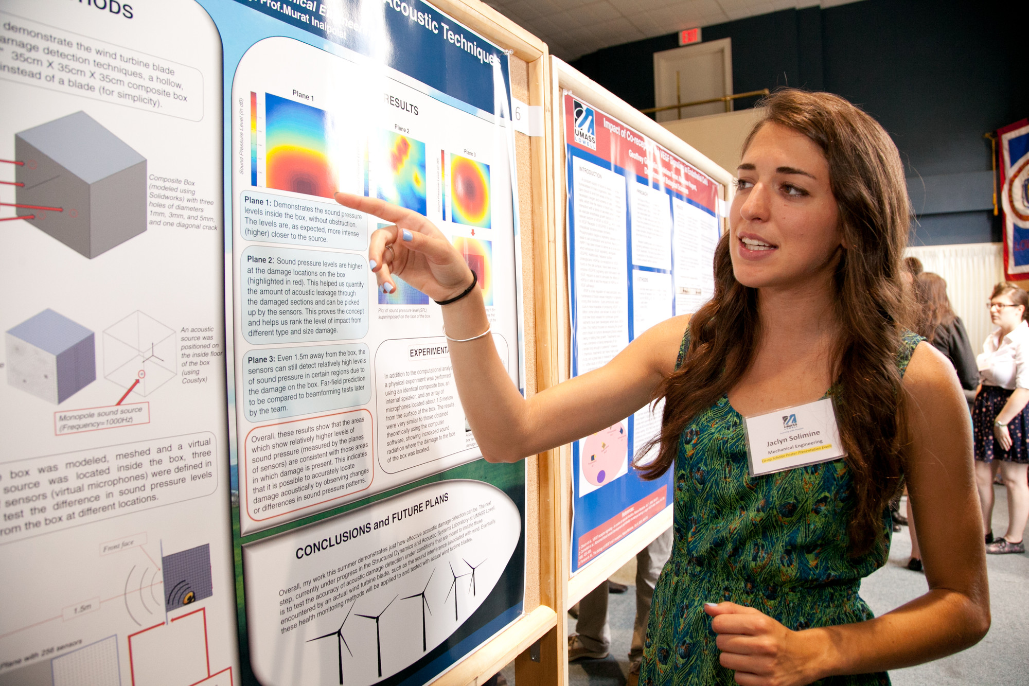 Female Graduate Student Presenting at Poster Session