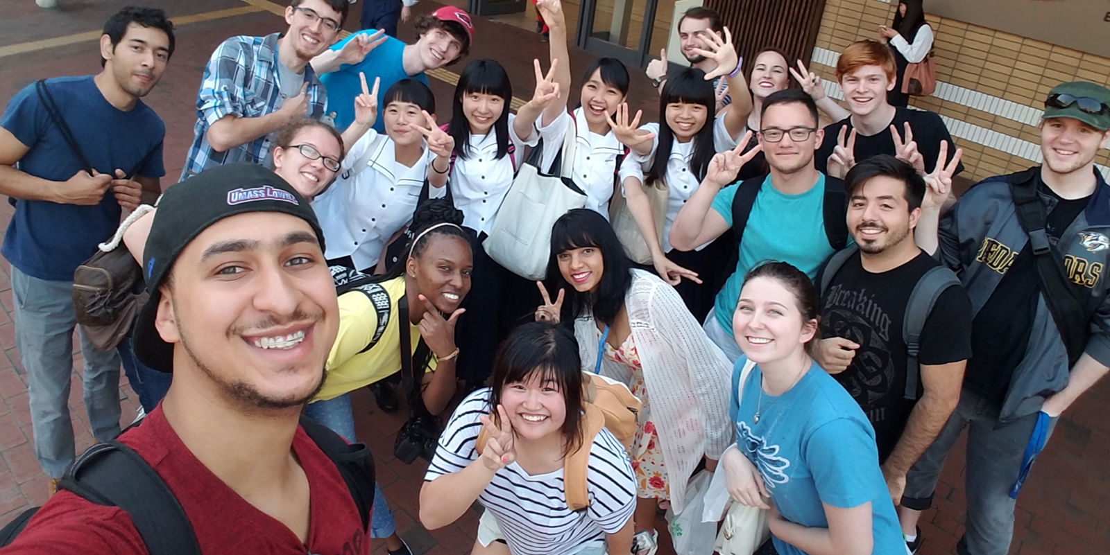 James Joutras poses with a group of students in Japan