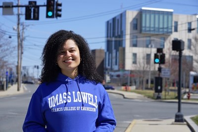 Graduate student Jenna Howard stands in front of University Crossing on Pawtucket Street