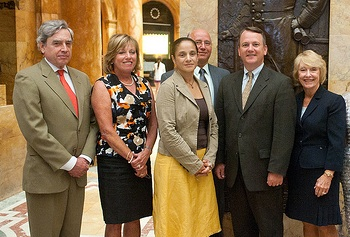 From left: Richard Freeland, Massachusetts commissioner of higher education; Pat Crombie, project director of the Massachusetts Action Coalition; Jessica Alvarez-Montano;  David Cedrone, associate commissioner for Economic and Workforce Development; Lt. Gov. Murray; and Sharon Gale, chief executive officer of the Organization of Nurse Leaders of Massachusetts and Rhode Island.