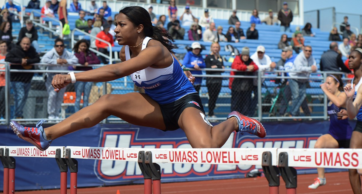 Jessica Amedee doing hurdles at a track event at UMass Lowell