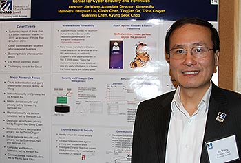 Prof. Jie Wang presents his poster announcing the new center for internet security and forensics during this year's Faculty Research Symposium.